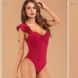 Red ruffle body suit